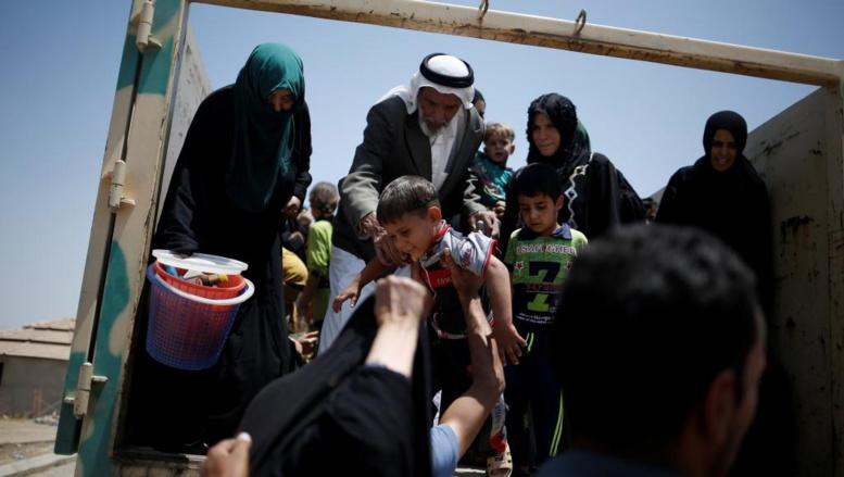Irak: des civils fuyant le groupe EI bloqués aux portes du Kurdistan irakien