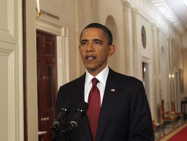 72% de la population soutient désormais la gestion de Barack Obama en matière de terrorisme contre seulement 51% en avril.  AFP PHOTO / Chris KLEPONIS