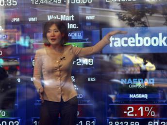Facebook fait son entrée en bourse ce vendredi 17 mai 2012 au prix de 38 dollars l'unité REUTERS/Keith Bedford