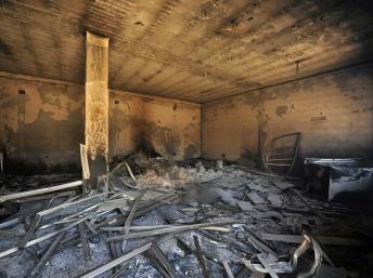 Un local des forces spéciales très endommagé, à Benghazi, le 15 juin 2013. REUTERS/Esam Al-Fetori