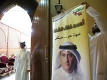 Préparation d'une salle de vote pour les sixièmes élections législatives en sept ans du Koweït, qui débute aujourd'hui 27 juillet 2013. AFP PHOTO/