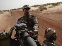 Soldats maliens dans la région de Tombouctou, le 27 juillet 2013. REUTERS/Joe Penney