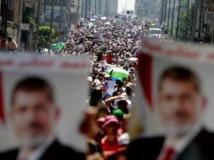 Des partisans du président Morsi, le 30 juillet au Caire. REUTERS/Mohamed Abd El Ghany