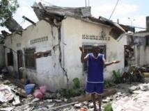 Maisons détruites par l'incendie qui a suivi l'explosion d'un dépôt d'armes à Mpila, spectacle d'apocalypse dans la capitale congolaise, le 4 mars 2012. AFP/Guy-Gervais Kitina