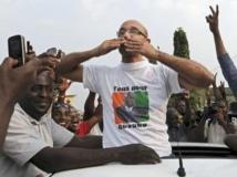 Michel Gbagbo à son arrivée au siège du FPI après sa mise en liberté provisoire, mardi 6 août 2013. AFP PHOTO / SIA KAMBOU
