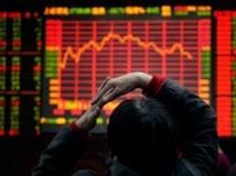 Une salle de marchés à Pékin, le 3 novembre 2008. (Photo : Reuters)