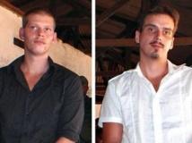 Joshua French (G) et Tjostolv Moland (D) avaient été accusés du meurtre de leur chauffeur congolais, de tentative de meurtre, d'espionnage et d'association de malfaiteurs et condamnés à mort par la cour militaire de Kisangani, en RDC. (photo de 2010) AFP PHOTO/ STRINGER