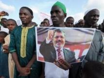 Un rassemblement s'est tenu à Dakar ce jeudi 22 août, en soutien aux partisans de Mohamed Morsi tués dans les manifestations en Egypte. AFP PHOTO / SEYLLOU