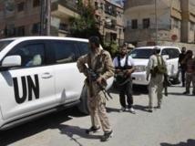 Des membres de l'Armée syrienne libre encadrent un convoi d'enquêteurs des Nations unies dans la banlieue de Damas, le 28 août 2013. REUTERS/Bassam Khabieh