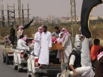Des militants islamistes à Sheikh Zuweid, le 10 août 2013. REUTERS/ Stringer