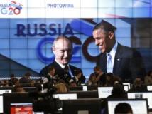Barack Obama et l'hôte du sommet du G20, Vladimir Poutine, le 5 septembre, sur l'écran géant de la salle de presse du G20. REUTERS/Grigory Dukor