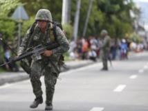 Un soldat dans une rue de Zamboanga, le 10 septembre 2013. REUTERS/Erik De Castro