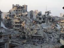 Un quartier de Homs, déserté, et complètement détruit par les bombardements de l'armée syrienne, le 13 juillet 2013. REUTERS/Yazan Homsy