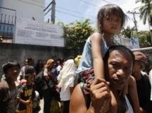 70 000 personnes ont été déplacés à la suite des combats entre le MNLF et les forces philippine à Zamboanga , dans le sud Philippines REUTERS/Erik De Castro