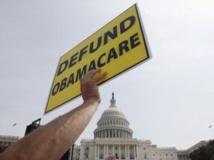 Des manifestants du Tea Party, le 10 septembre dernier, manifestant contre la réforme phare de Barack Obama sur la santé, dite «Obamacare», à Washington. REUTERS/Jonathan Ernst