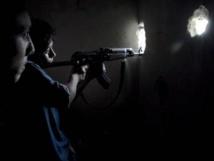 Des combattants de l'Armée syrienne libre, à Alep, le 22 septembre. REUTERS/Loubna Mrie