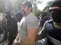 Yannis Lagos, l'un des leaders d'Aube dorée, à son arrivée au tribunal ce mardi 1er octobre. REUTERS/Giorgos Moutafis