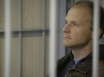 Denis Sinyakov, photographe de l'organisation Greenpeace, à la Cour de Mourmansk, le 26 septembre 2013 REUTERS/Igor Podgorny