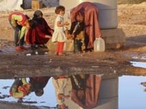 Des réfugiés dans un camp jordanien, à Mafraq, non loin de la frontière syrienne. REUTERS/Muhammad Hamed