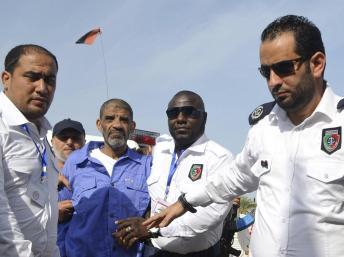 Senoussi, ancien bras droit de Kadhafi, devrait être jugé en Libye