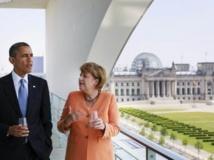 Barack Obama et Angela Merkel, le 19 juin 2013 à la chancellerie de Berlin, devant le Parlement. REUTERS/Bundesregierung/Steffen Kugler/Handout via Reuters