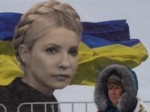 Malgré le froid et la neige, les manifestants pro-européens restent mobilisés à Kiev, ce lundi 9 décembre. AFP PHOTO/VASILY MAXIMOV