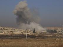Nuage de fumée résultant de l'explosion d'une bombe non loin d'Alep, le 21 décembre 2013. REUTERS/Ahmad Othman
