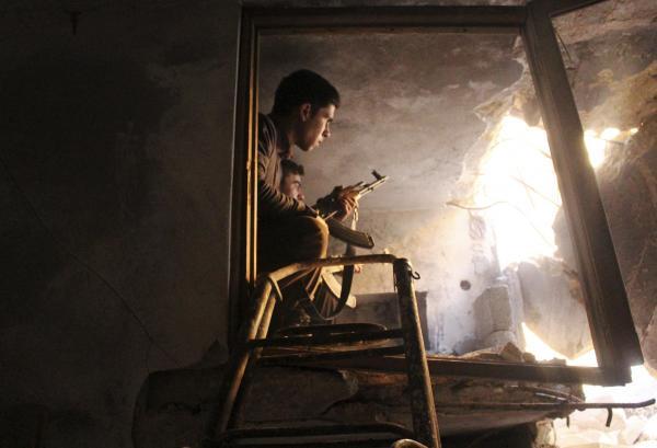 Combattant de l'Armée syrienne libre, le 21 décembre à Alep. REUTERS/Abdalrhman Ismail