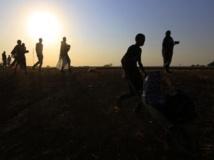 Des réfugiés sud-soudanais arrivent vers Juba après avoir fui les combats, le 16 janvier 2014. REUTERS/Mohamed Nureldin Abdallah