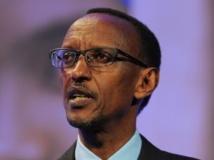 Paul Kagame (ici le 11 juillet 2012 à Londres) a longtemps entretenu de très proches relations avec la Grande-Bretagne. AFP PHOTO / CARL COURT