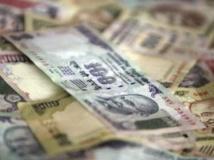Marchés financiers: les monnaies des pays émergents sous pression
