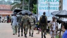 Une patrouille dans les rues de Duékoué. La région est soumise à des attaques récurrentes, menées par des groupes venus du Liberia voisin.