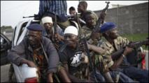 Des jeunes soldats alliés aux forces fidèles à Alassane Ouattara le 11 Avril 2011 dans les rues d'Abidjan.