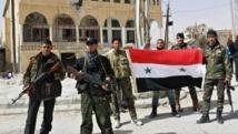 Des combattants pro-gouvernementaux dans le village de al-Sahel, aux abords de Yabroud, le 4 mars, dix jours avant la victoire des forces du régime.