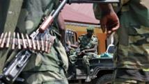 Des soldats du M23 à Bunagana, le 7 avril 2013. AFP PHOTO/ ISAAC KASAMANI