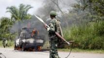 Un soldat congolais de la FARDC, près du village de Mazizi, le 2 janvier 2014. REUTERS/Kenny Katomb