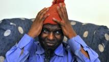 Kumba Yala, ici en 2012, avec son fameux bonnet rouge. AFP PHOTO/ ISSOUF SANOGO