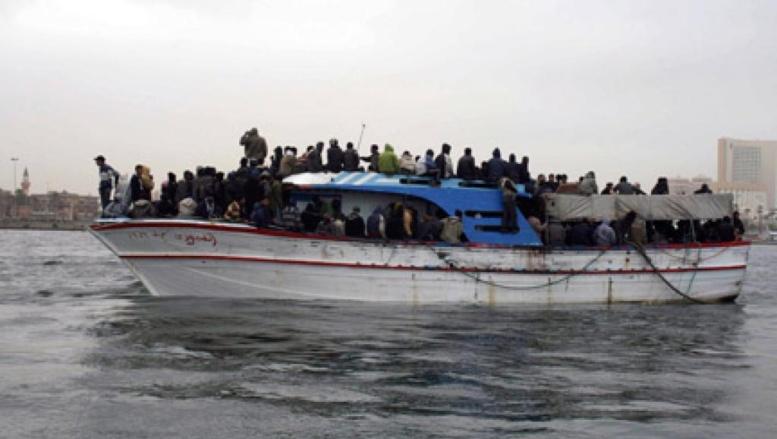 Arrivée au port de Tripoli d'une embarcation, avec des clandestins rescapés à bord (photo archive, le 29 mars 2009).