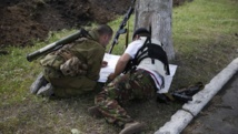 Miliciens pro-russes à Donetsk où la situation était toujours confuse le 30 mai 2014. REUTERS/Maxim Zmeyev