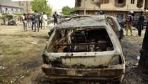 Une carcasse de voiture après un attentat à Kano, au nord du Nigeria, le 19 mai 2014. REUTERS/Stringer