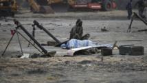 Un rebelle sud-soudanais près de son arme, le 15 février 2014. REUTERS/Goran Tomasevic