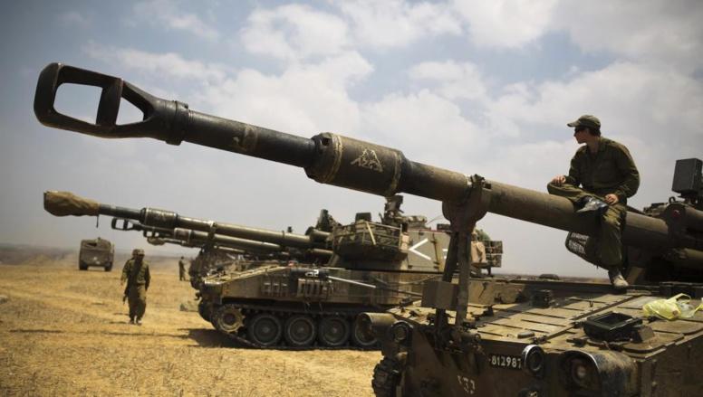 Des soldats israéliens positionnées près de la bande de Gaza, le 22 juillet 2014. REUTERS/Amir Cohen