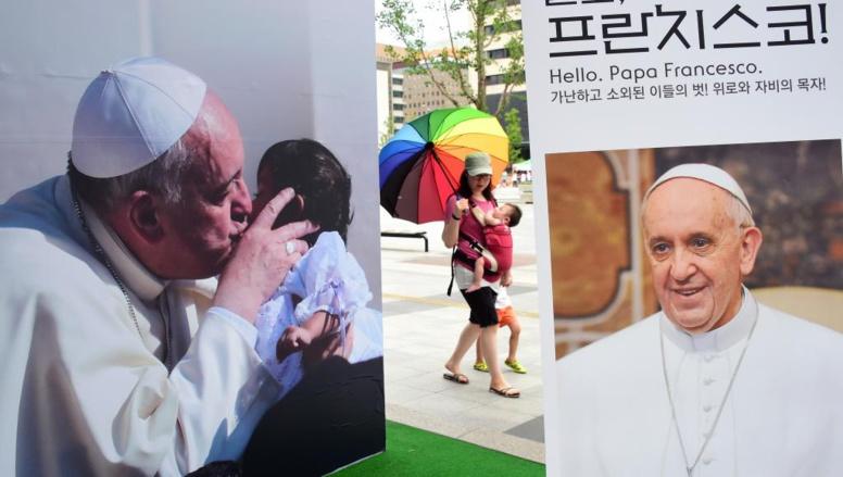 Les Séouliens sont prêts à accueillir le pape François, ce mercredi 13 août 2014. AFP PHOTO / JUNG YEON-JE