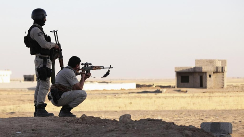 Deux pershmergas dans la province de Ninive, en Irak, le 9 août 2014. REUTERS/Ari Jalal