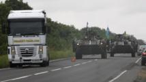 Des vénicules blindés patrouillent autour de Donetsk, le 18 août 2014. REUTERS/Valentyn Ogirenko