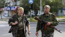 Des séparatistes prorusses dans les rues de Makiïvka, le 19 août 2014. REUTERS/Maxim Shemetov