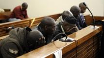 Les six personnes suspectées d'avoir tenté d'assassiner l'ex-chef d'état-major rwandais Kayumba Nyamwasa en juin 2010 (photo prise au début du procès, en 2012). AFP PHOTO / STEPHANE DE SAKUTIN
