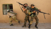 Entraînement de la milice chiite de l'armée du Mahdi, près de Tikrit, en Irak, avant d'affronter l'organisation Etat islamique. REUTERS/Ahmed Jadallah