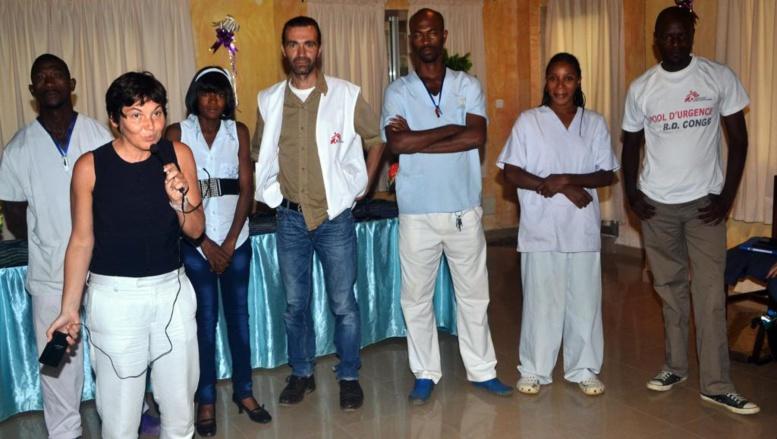 Annick Girardin au centre d'isolement de Médecins sans frontières à l'hôpital Donka de Conakry, le 13 septembre 2014. AFP PHOTO / CELLOU BINANI