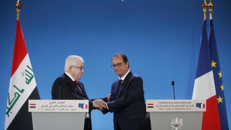 Le président irakien, Fouad Massoum et son homologue français François Hollande à l'ouverture de la conférence de paix à Paris le 15 septrembre 2014. REUTERS/Christian Hartmann